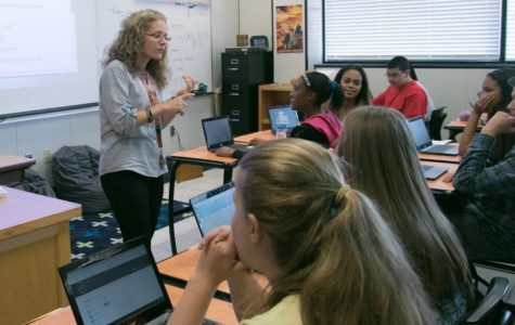 Algebra 2 teacher Nicole Ayers teaches a lesson. Ayers has been part of the tiger family for three years and will now teach at St. James.