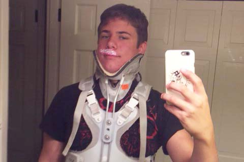 Junior Briley Court photographs himself with his hospital brace. He was hospitalized after an impactful car accident.