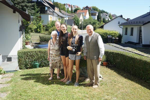Charli Hüter and her family pose in front of her grandparents home in Hessen, Germany. Charli visited her family this past summer.