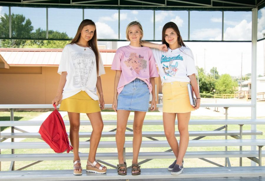 Juniors+Faith+West%2C+Emily+Stroud+and+Anna+Grace+Jones+show+off+their+tacky+T-shirts+in+time+for+the+new+school+year.+School+will+begin+on+Aug.+15.