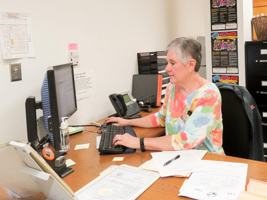 Registrar Kim Byerly looks over student transcripts for the final time. Mrs. Byerly retired on Aug, 8.