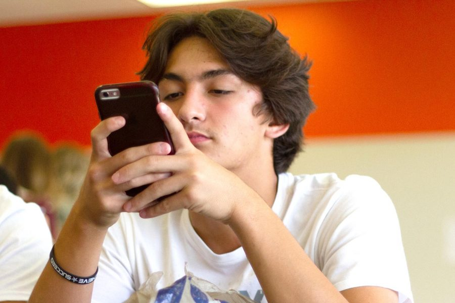Senior Cole Jean takes advantage of the schools new cell phone policy. The 2018-19 school year will allow phones to be used at lunch.