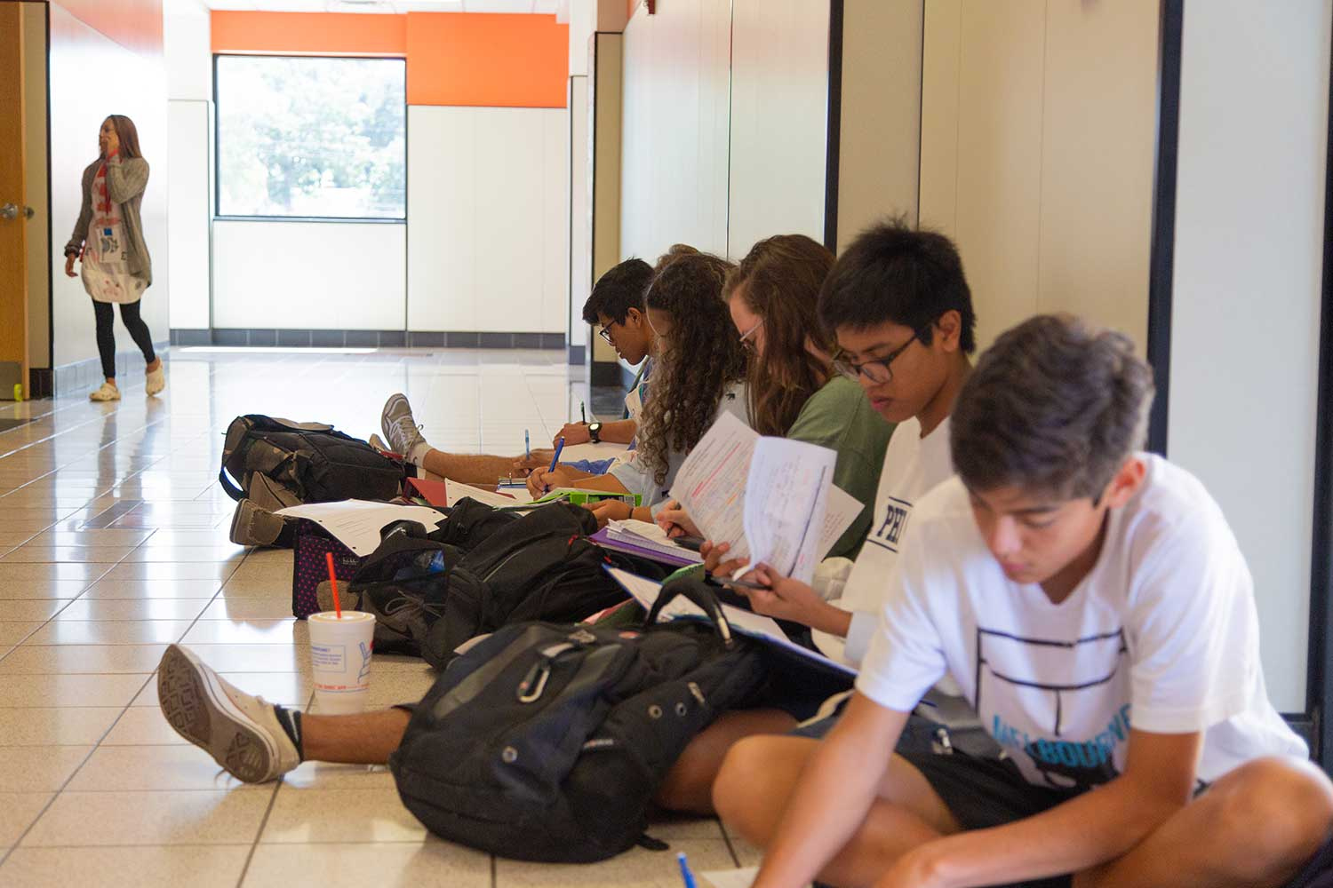 Mrs. Martin's students in the Math and Science building sit outside of class. There was a suspected gas leak that was caused by sewage water evaporating from the pipes in the sinks of the science classrooms.