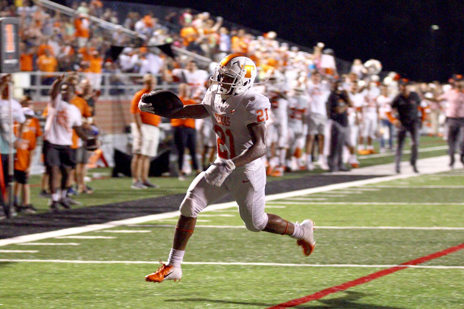 Running back Chris Sutton extends the ball as he crosses the goal line in the Texas High Tigers win against the Liberty Eylau Leopards September 14, 2018. The Tigers improved their record to 2-1 with the win against their cross--town rival.