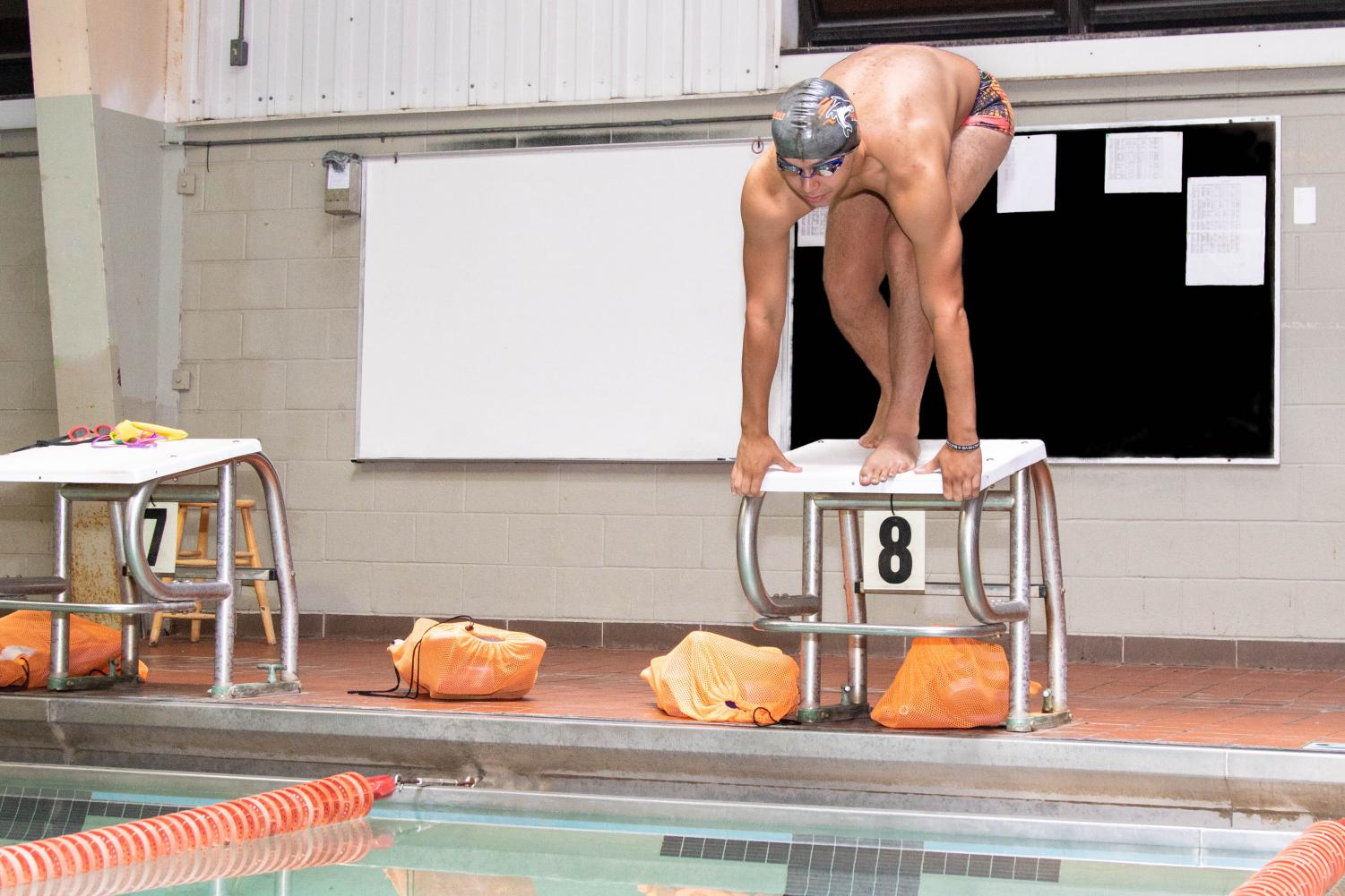 Sophomore Logan Diggs prepares to dive into the pool. Diggs uses swim to find his own identity apart from siblings.