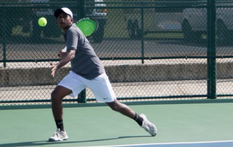 Junior Jebin Justin prepares to return a shot against Evangel. The tennis team won this match and has found early season success.