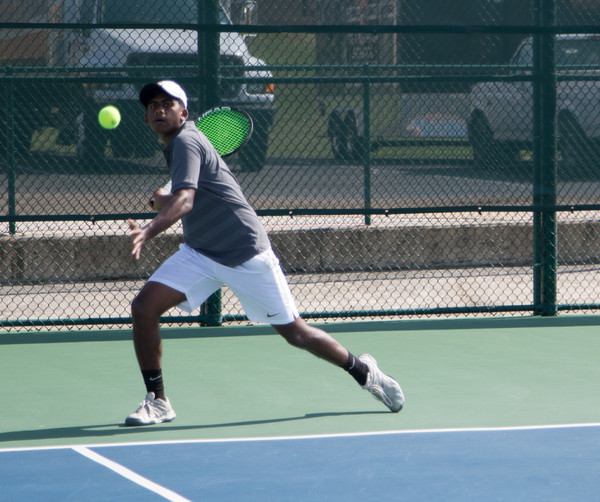 Junior Jebin Justin prepares to return a shot against Evangel. The tennis team won this match and has found early season success.