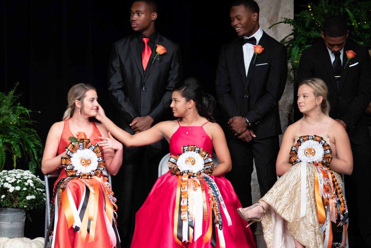 Senior Kearstan Williams wipes a tear away from fellow maid senior Allison Yancey during emotional moment shared on stage.