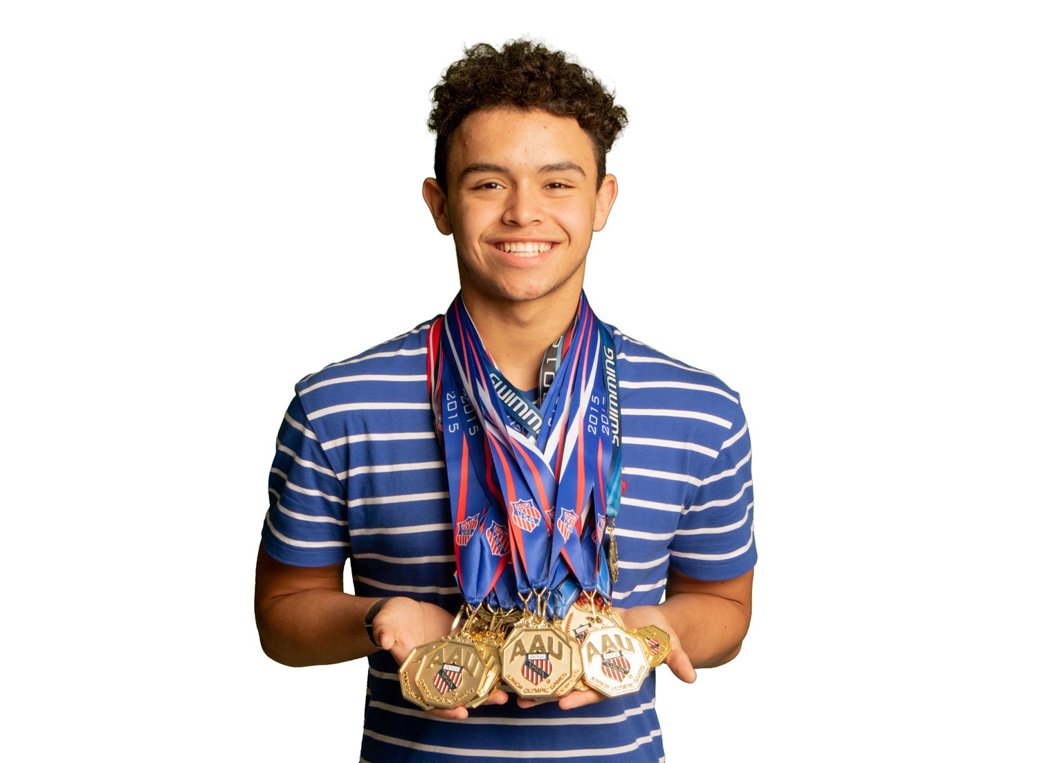 Sophomore Logan Diggs shows off his various first place medals from competing in the Junior Olympics. Diggs participated in the 2018 Junior Olympics and placed in four events.
