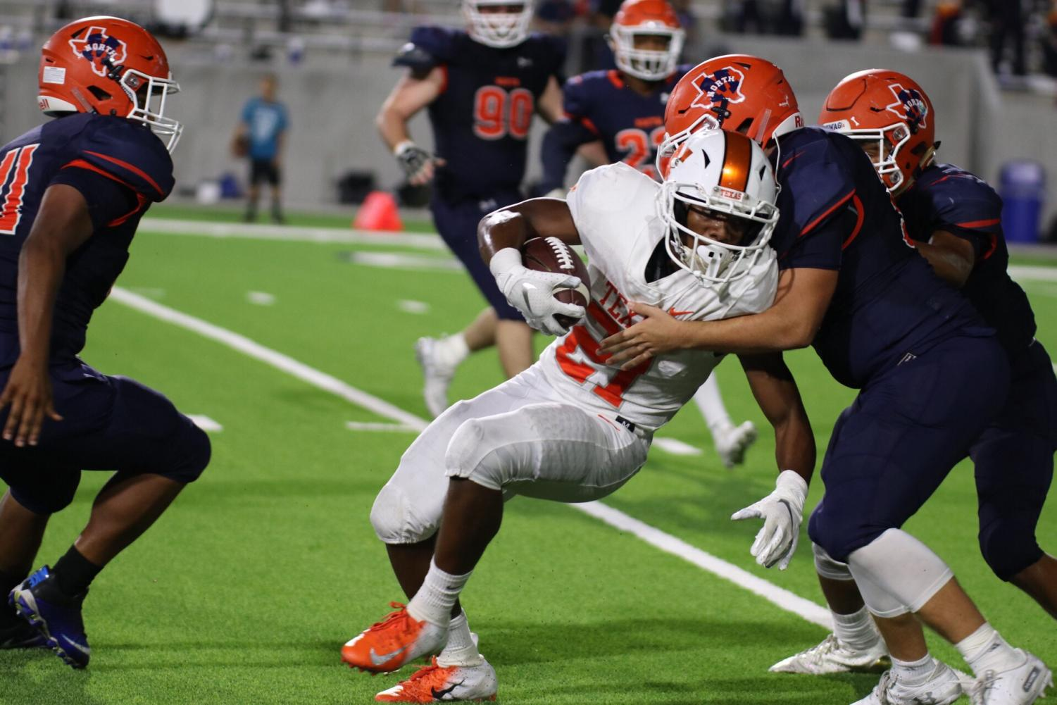 Texas High's Chris Sutton  drives his shoulder into a McKinney defender in the third quarter of the game held in McKinney on October 5, 2018. The Tigers lost to the Bulldogs 47-44.