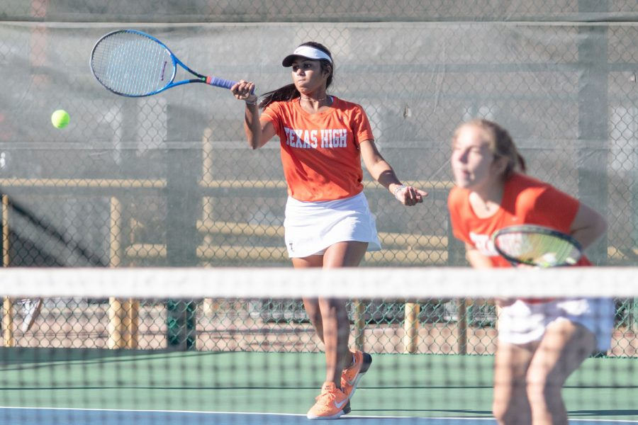 Shreya Kurichety returns a volley durring a doubles match against Lyndale on Thursday October 11th 2018 District Championship game. The Tiger tennis team took the victory at the tournament.
