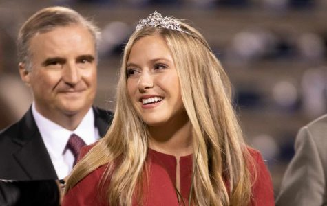 Senior Sarah Grace Boudreaux smiles as after being named 2018 Homecoming queen before the footbal game against Wylie East. Seniors Grace McGuire and Treyaunna Rush tied in voting and share the Maid of Honor title.