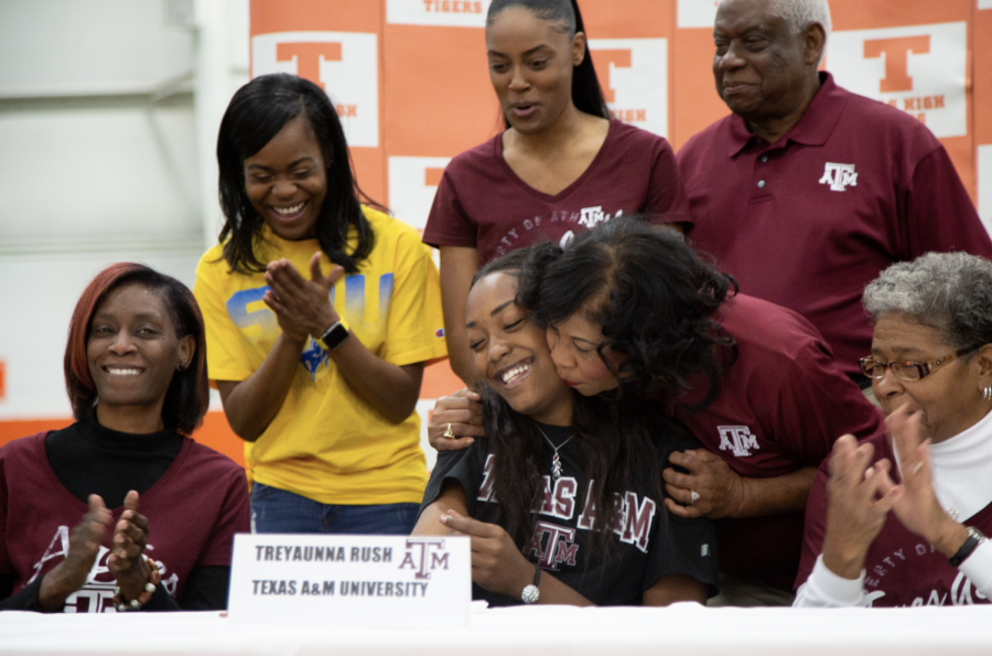 Family+members+of+senior+Treyaunne+Rush+congratulate+her+as+she+signs+her+letter+of+intent+to+Texsa+A%26M+University.+Four+seniors+signed+with+their+respective+colleges+to+further+their+athletic+careers.+