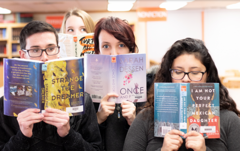 Students hold a select few of the 2018-2019 book challenge novels. The challenge started in late October.