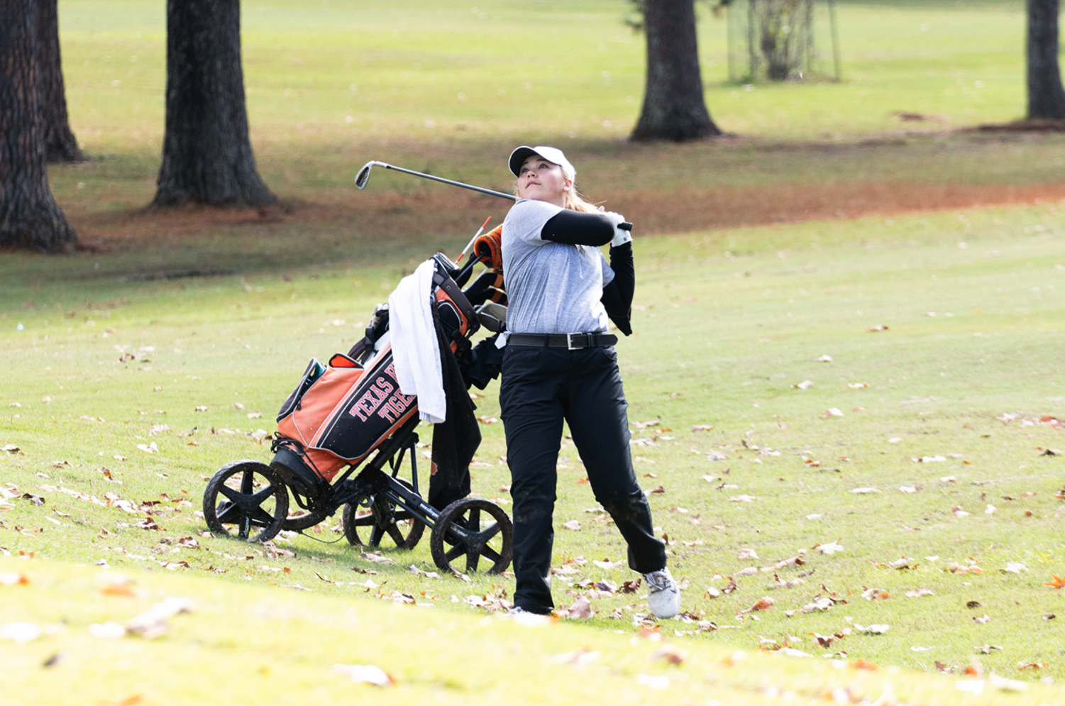 Sophomore Gracie Henard swings her golf club. Colleges noticed Henard's abilities and potential.