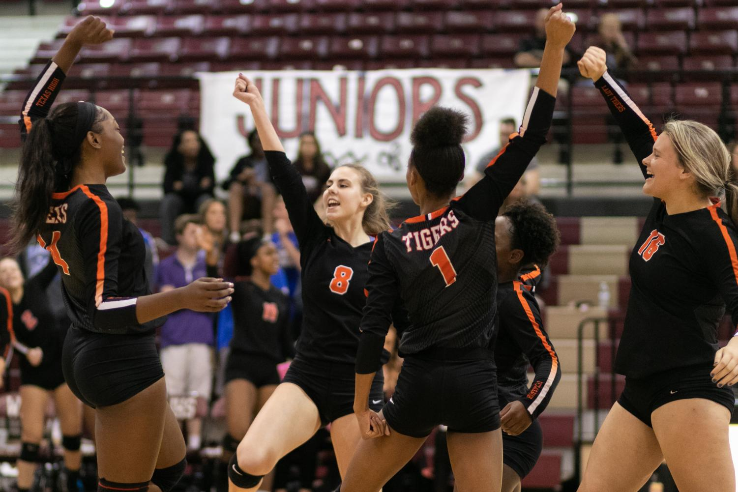 The Lady Tigers celebrate after scoring a point against the Joshua Lady Owls in the regional quarterfinal. They play the Wakeland Wolverines on Friday at Richardson Berkner High School at 5 p.m.