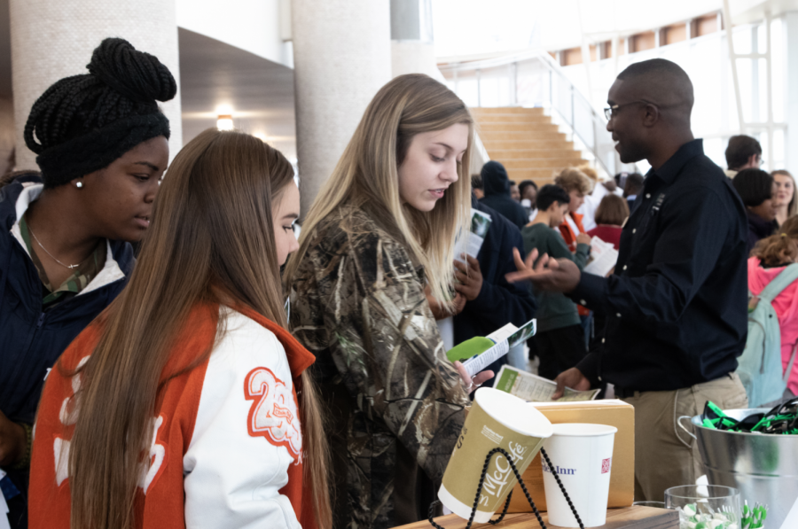 Seniors+Elaina+Roberson+and+Kylee+Spriggs+observe+brochures+during+the+career+fair+last+week.+The+fair+attracted+various+students+looking+for+local+job+opportunities+in+Texarkana.+