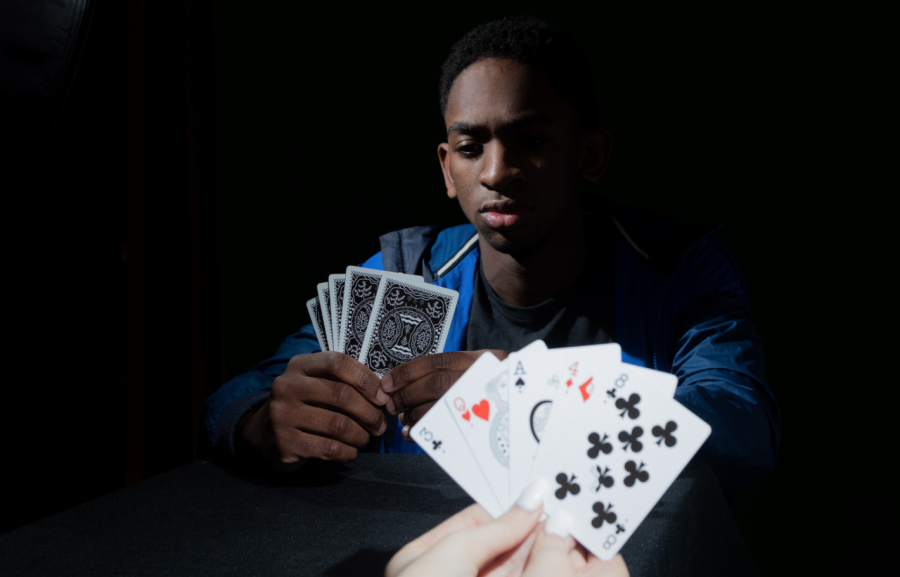 Junior Cameron Alcorn focuses on his hand of cards. He is currently playing Speed, a quick-paced and competitive card game.