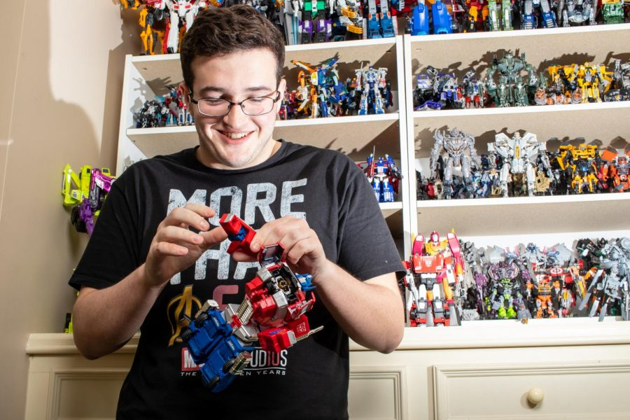 Senior Hayden Fant disassembles an Optimus Prime action figure. Hayden showed off his collection of Transformers estimated to be worth $10,000.