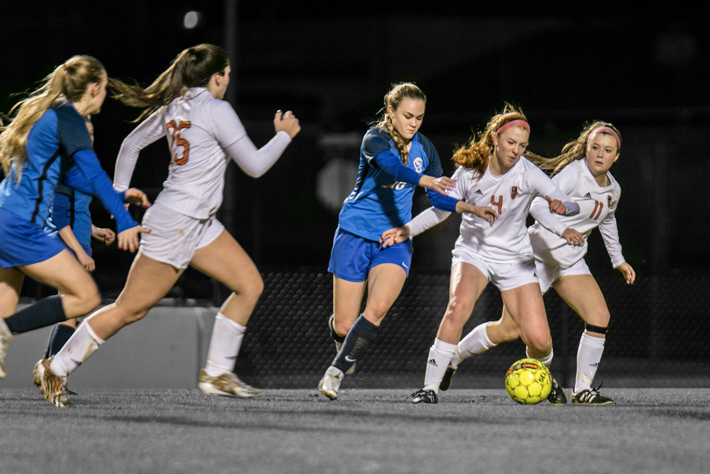 Senior Abigail Deleon (4) shields the ball from a Sulphur Springs defender with support from former senior Jillian Ross and senior Sarah Jane Paddock. file photo
