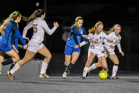 Girls' team sets their eyes on playoffs despite new district