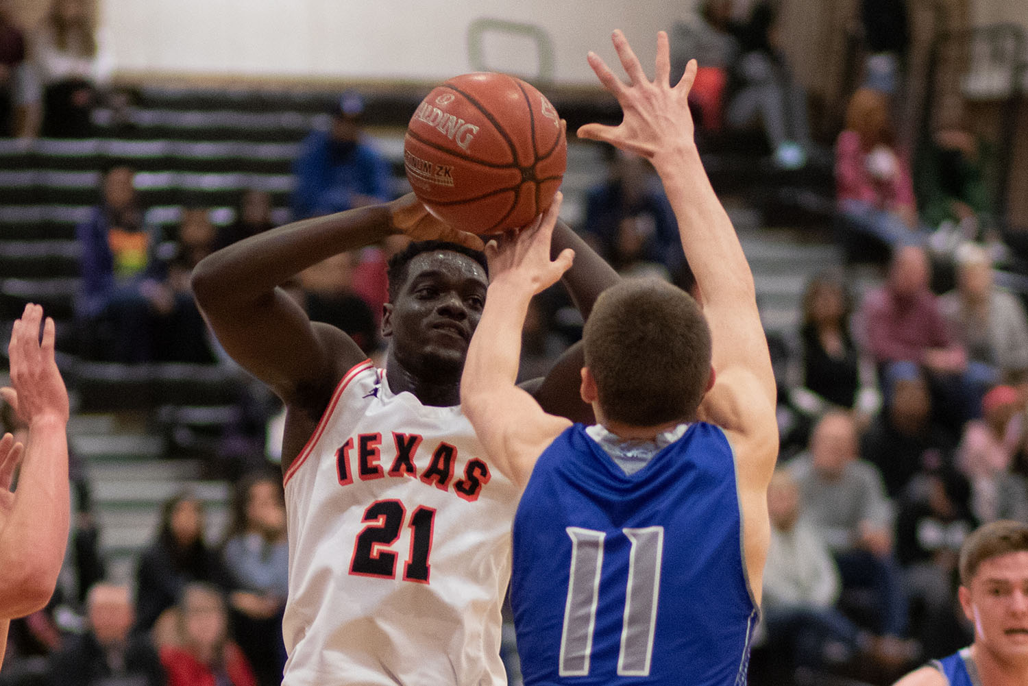 Senior Demarquis Vaughn attempts to pass the ball. The Tigers won against Lindale on Jan. 15.