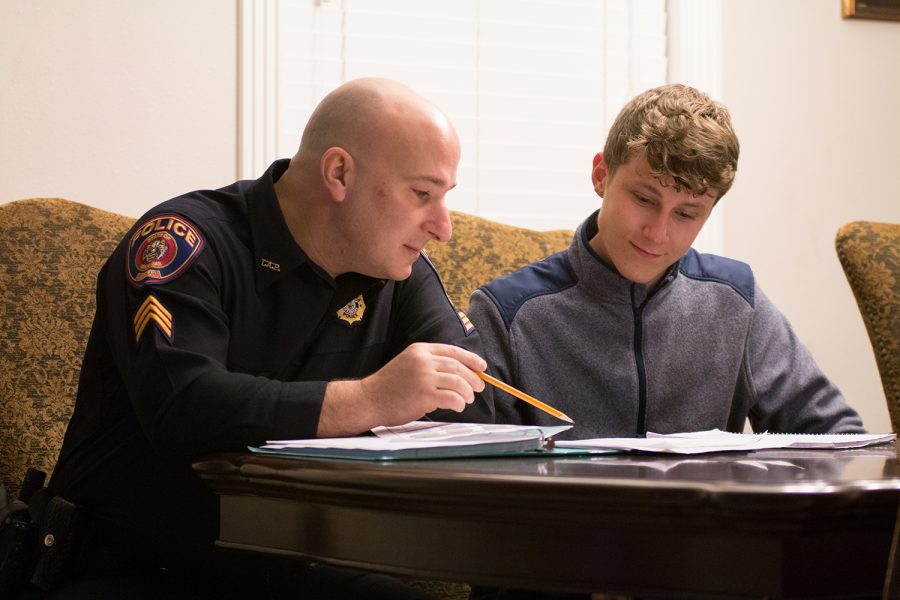 Texarkana, Arkansas Sgt. Jeremy Gordon helps senior Garret Burks with his homework as part of the Police Mentoring Program. Some believe that police officers are misunderstood and stereotyped.