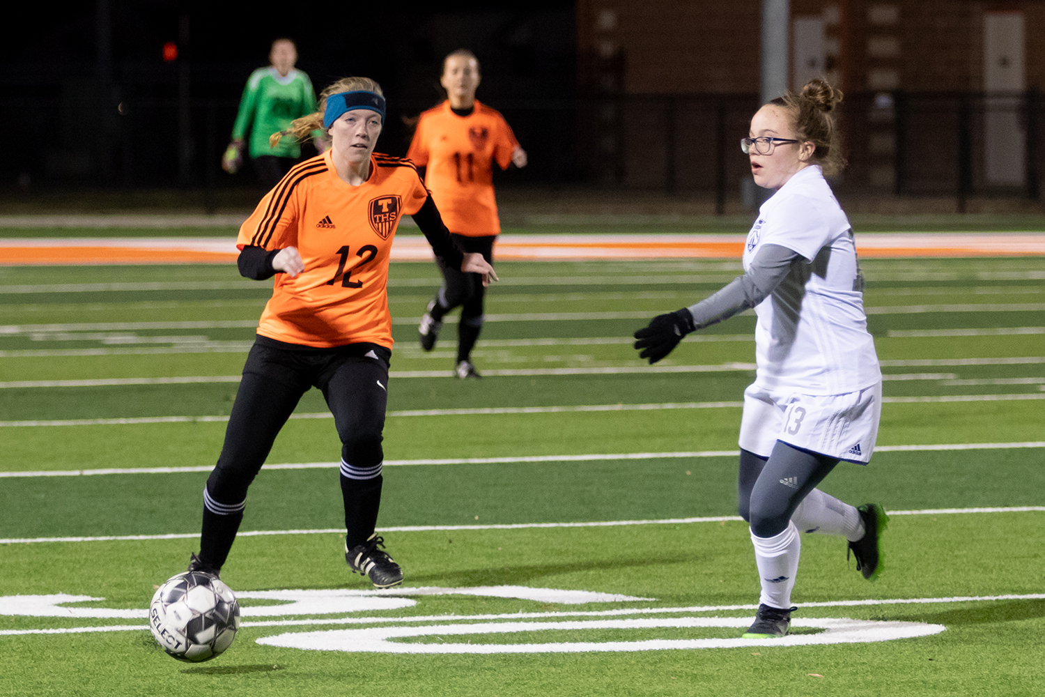In a game against the Paris Lady Cats, sophomore Janie Rounds moves the ball down field. The Lady Tigers won 4-1.