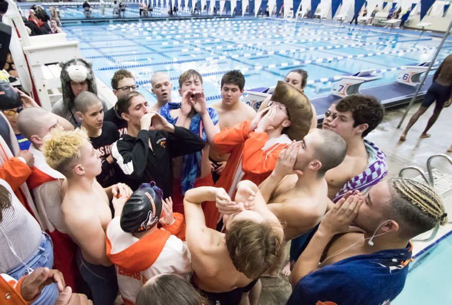 The Tigersharks chant before the first today of the regional meet in Frisco, Texas.