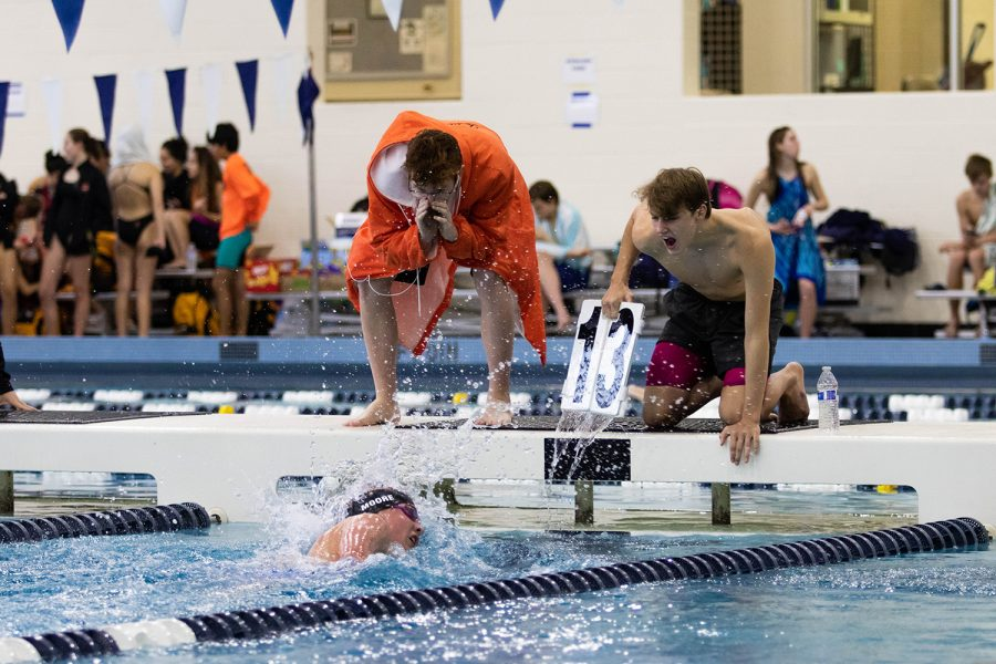 Senior Jackson Shellogg cheers on his teammate at a swim meet in Dallas, Texas. Shellogg strives for excellence while overcoming his dyslexic disability.