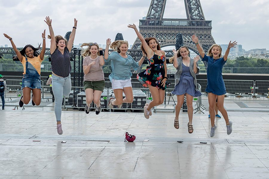 Several junior girls jump in front of the Eiffel Tower in Paris, France. A group of students visited various European countries in summer 2018.