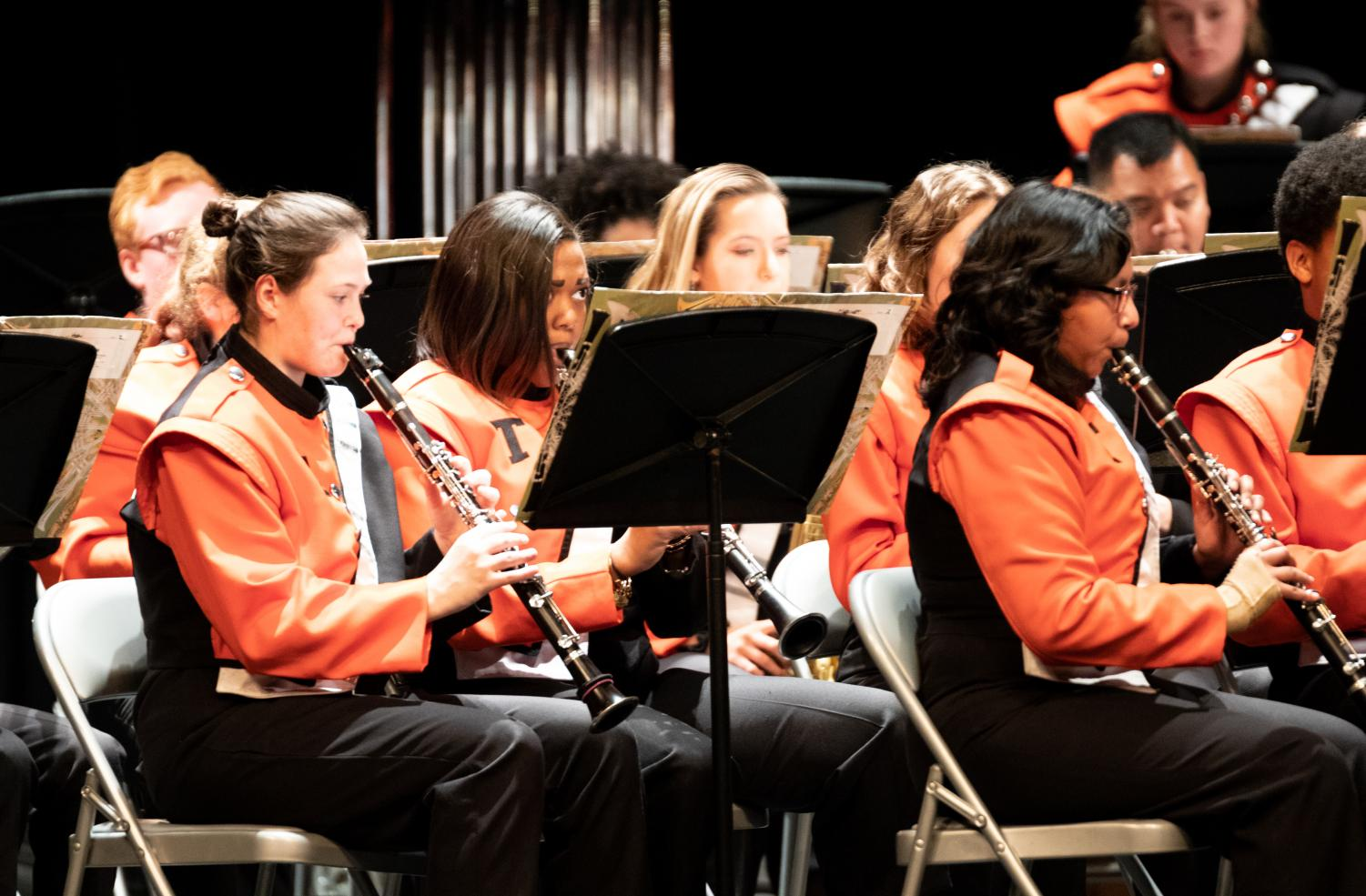 Junior Lillian Lovett glances at her music while playing in the clarinet section at the Tiger Band Christmas concert. Band and Choir members competed in Solo and Ensemble contests on Feb. 7 and Feb. 8.