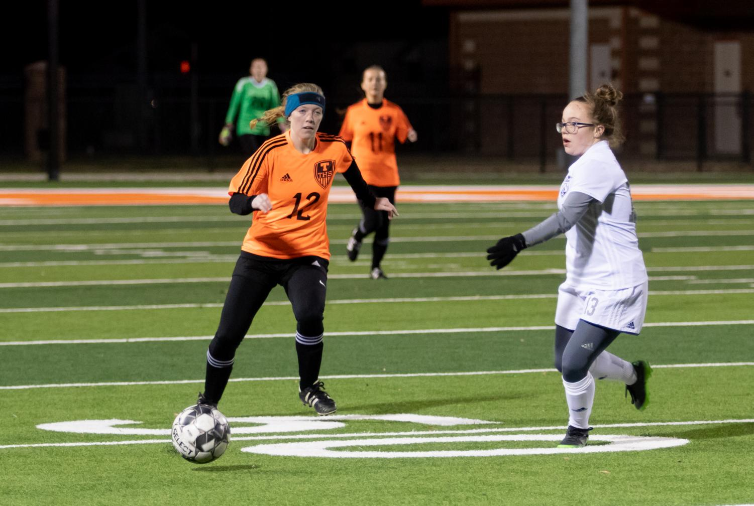 Sophomore Janie Rounds goes after the soccer ball. The girls soccer team played against the Greenville Lions.