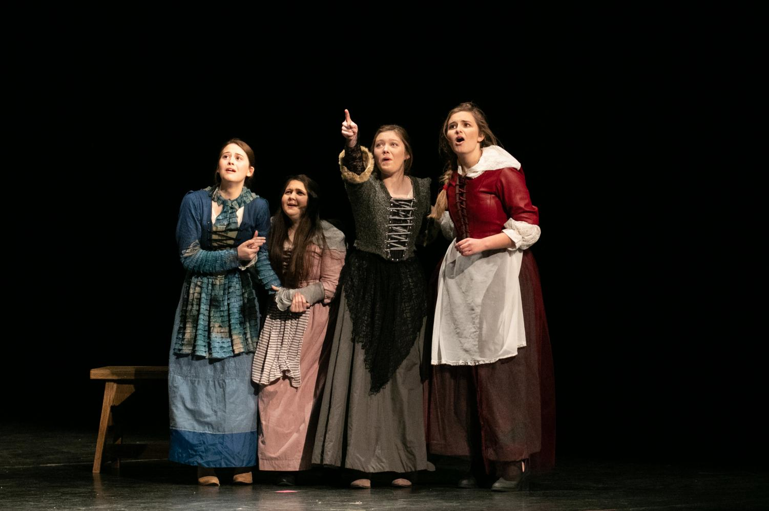Sophomore Cate Rounds, junior Addison Cross, and seniors Rachel Johnson and Abby Cannon point and gaze offstage in horror. The Tiger Theatre Company's UIL One Act Play troupe placed second at the district meet on Tuesday.