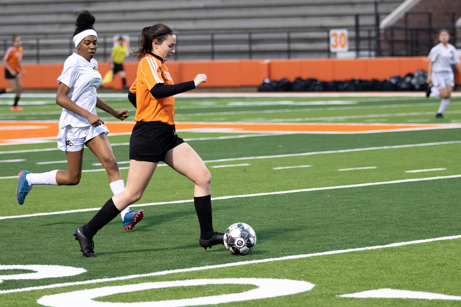 Traveling across the soccer field, sophomore Megan Dineen dribbles down the sideline. The Lady Tigers played against Sulphur Springs.