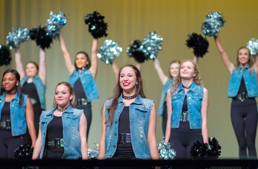 Senior+Isabelle+Robertson+smiles+as+the+pom+routine+ends+during+Spring+Show.+Spring+Show+was+the+last+place+to+showcase+the+dances+of+the+HighSteppers+2018-2019+season.