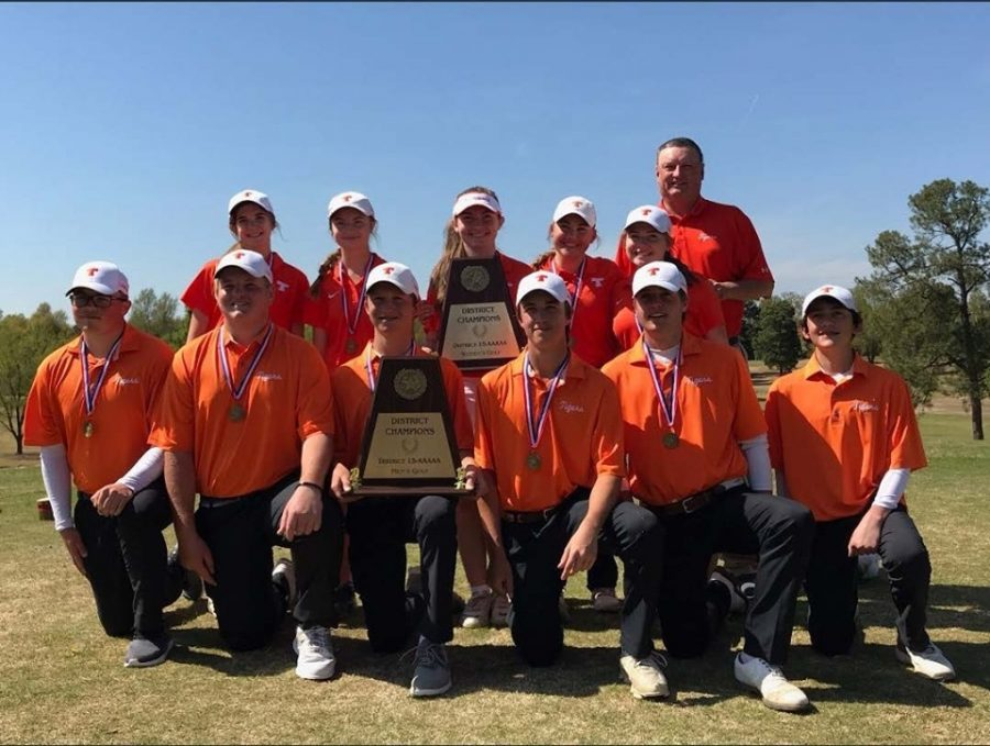 Golf coach Jay Brewer stands with members of the Texas High golf team after a team victory.