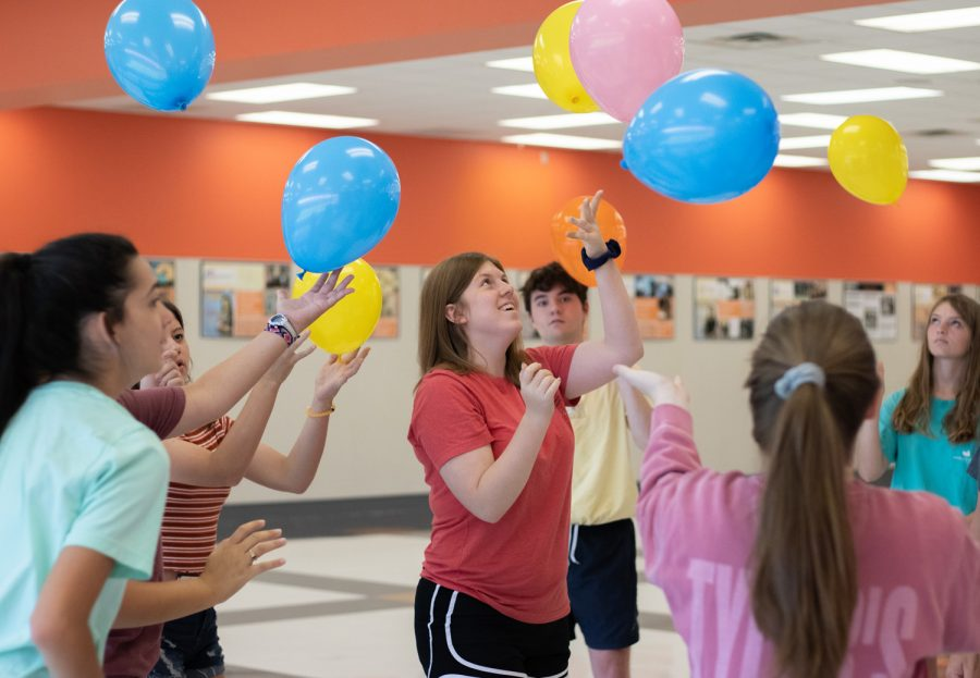 "Junior newspaper section editor Kate Morgan bounces balloons to keep them off the ground in a group game. Morgan and other students slowly left the circle and the balloons to the remaining students to continue the game. ""The game symbolized how that sometimes whenever you get distracted from your journalism work that other people have to pick up that slack to make deadlines."""