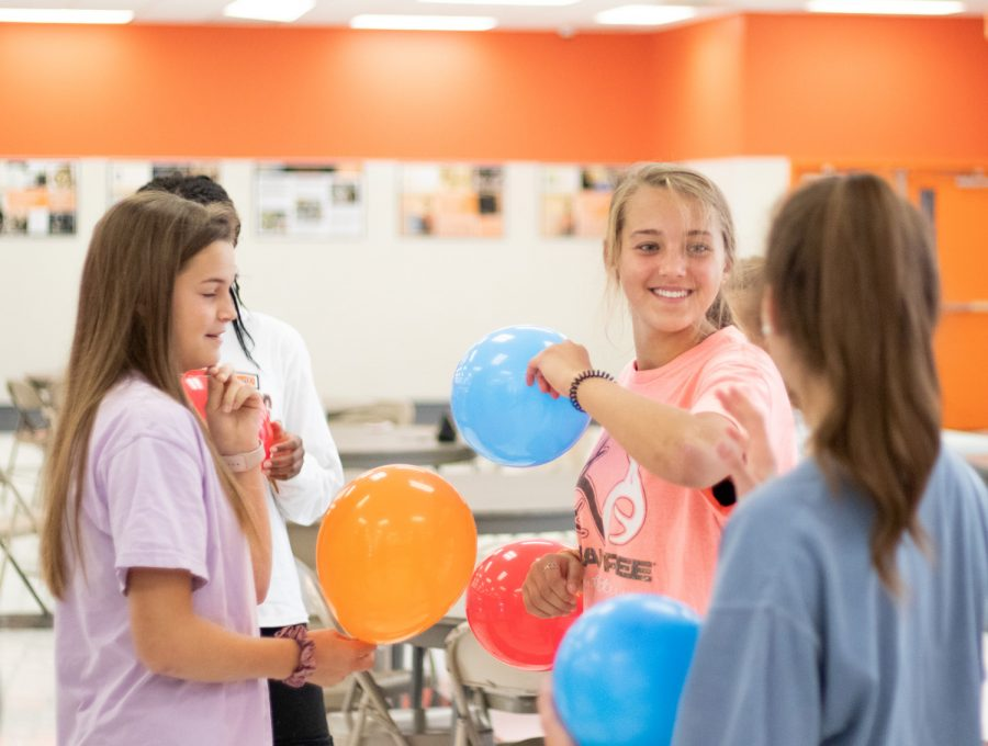 Sophomore+Carrigan+Brush+gets+in+balloon+fight+with+friends+during+team+building+exercises+at+this+year%E2%80%99s+publications+bootcamp.+Yearbook+students+spent+the+morning+using+balloons+to+practice+teamwork+and+communication.+%E2%80%9CWe+were+preparing+to+go+play+a+new+game+and+my+friend+ellison+%5BDavis%5D+hit+me+in+the+face+with+her+balloon.%E2%80%9D+Brush+said.+%E2%80%9CThe+game+gave+me+assurance+that+we+have+a+lot+of+teamwork+in+yearbook+this+year.%E2%80%9D%0A