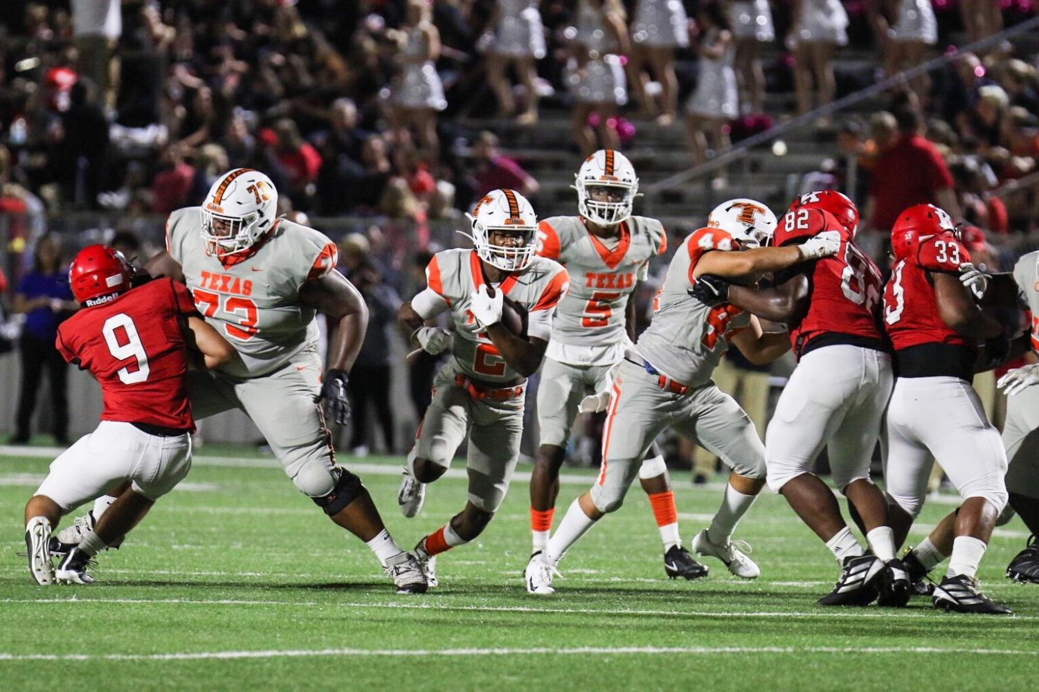 Senior Tracy Cooper runs the ball in the first quarter. Texas High School played against Kilgore High School on September 20, 2019.