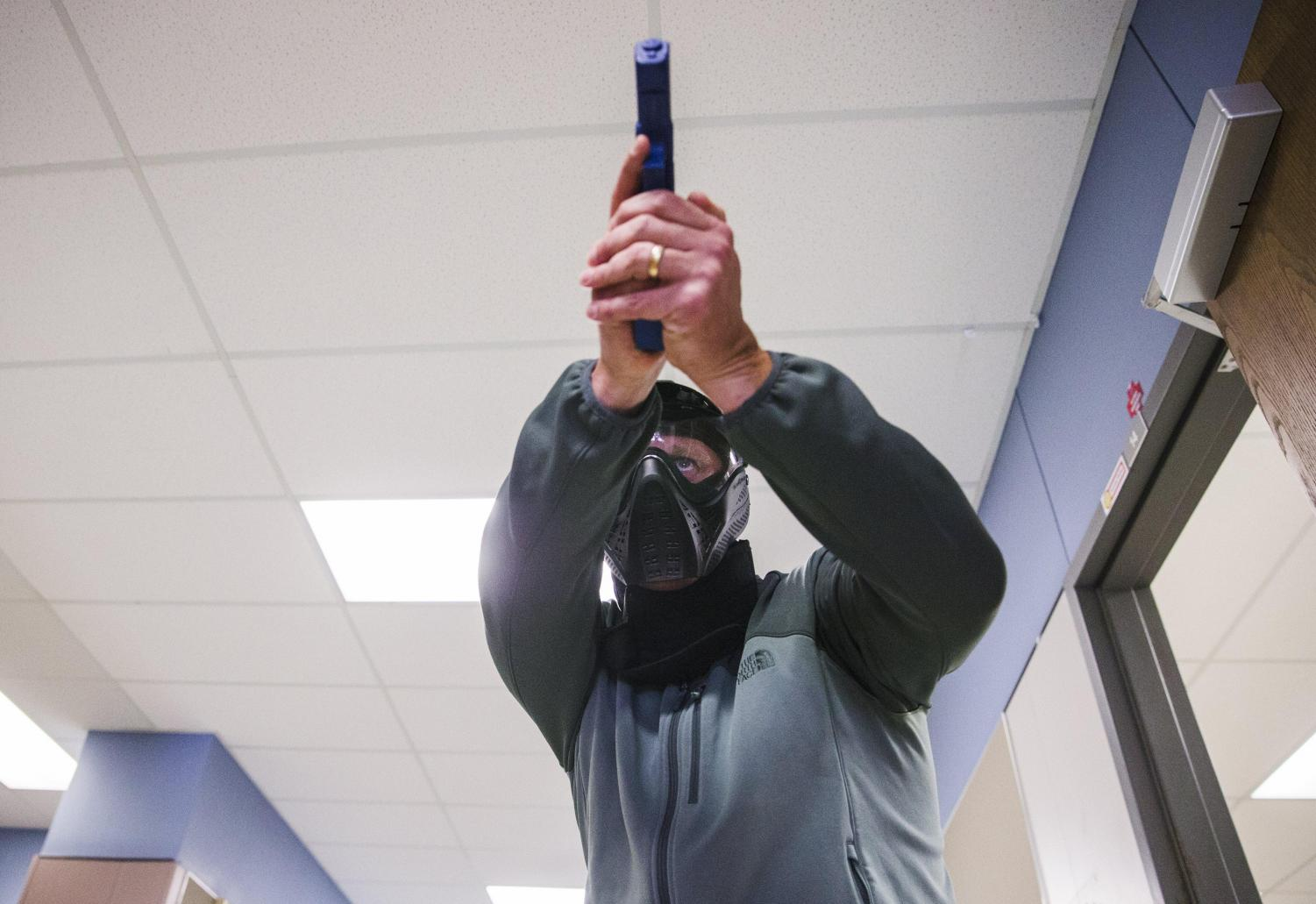 School marshal students demonstrate scenario exercises with simulated firearms as part of a Texas Commission on Law Enforcement training at Windermere Elementary School in 2018. [AMANDA VOISARD / AMERICAN-STATESMAN]