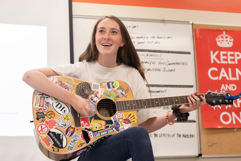 Junior Lia Graham leads the guitar club in a