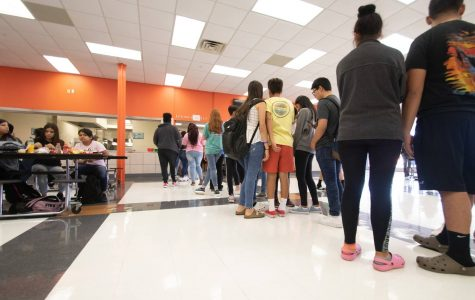 The lines continue to grow as students wait to pick their lunch. The students rushed to the lunch line to get first pick of their food.