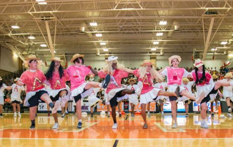 Texas High mocks Arkansas High in the annual tradition of the A-line dance as they prepare for the big game tonight. The students cheer and rally to show their support for the Texas vs. Arkansas game.