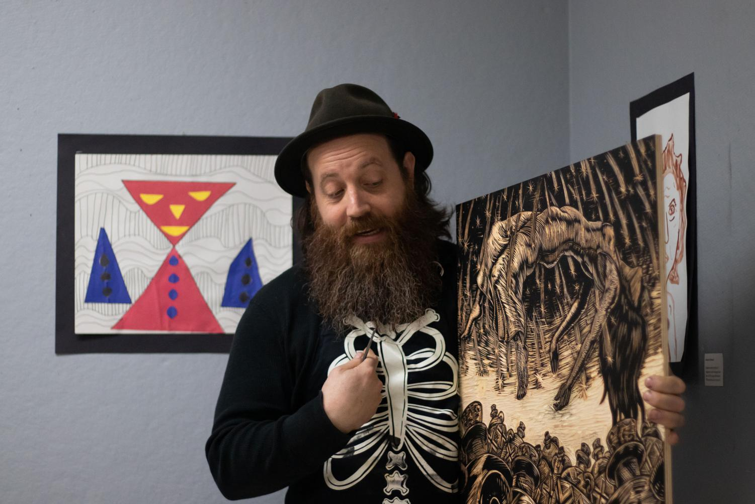 On Oct. 25, artist Neal Harrington explains a print he created to the Texas High Art Club. Harrington's work is currently displayed downtown in the gallery at the Texarkana Regional Arts and Humanities Council.