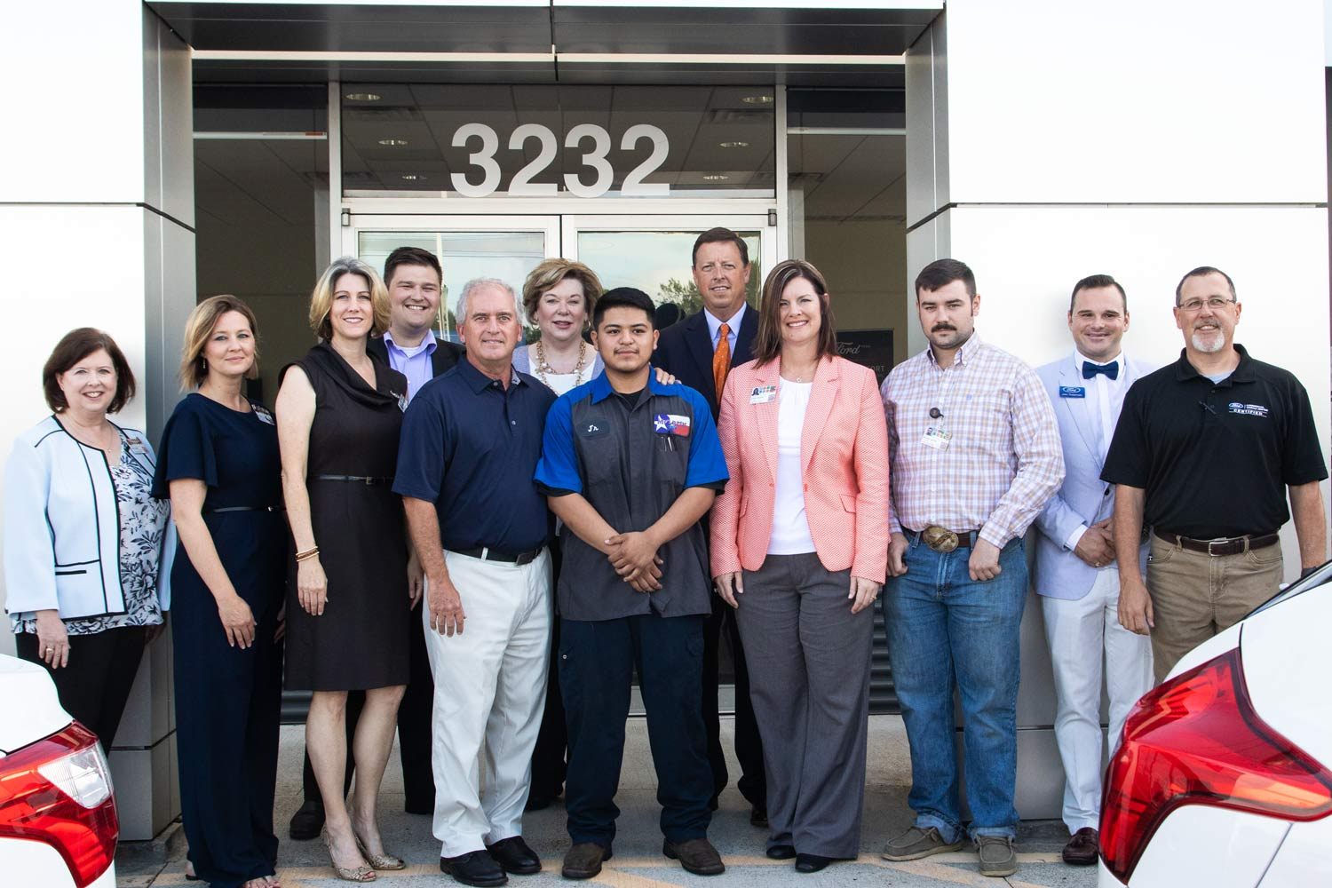 TISD and Ford representatives stand with graduate Alejandro Zarate after press conference