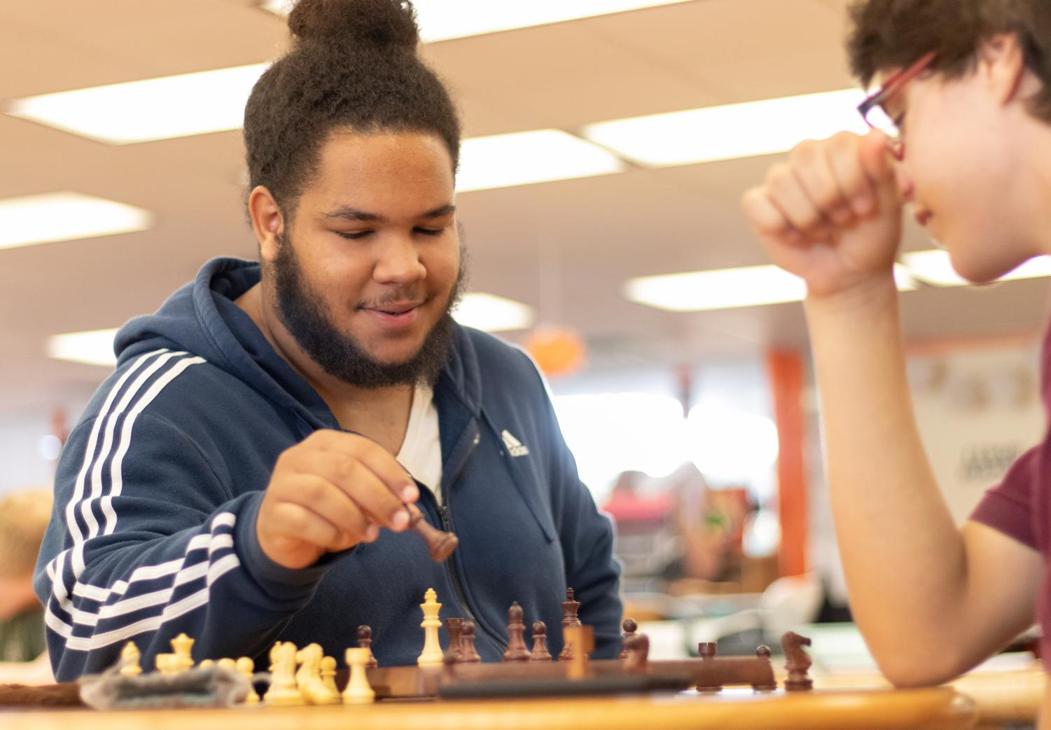 Junior Keenan Thrapp ponders his next move in a game of chess. Thrapp's love of chess developed at an early age with his mother's encouragement.