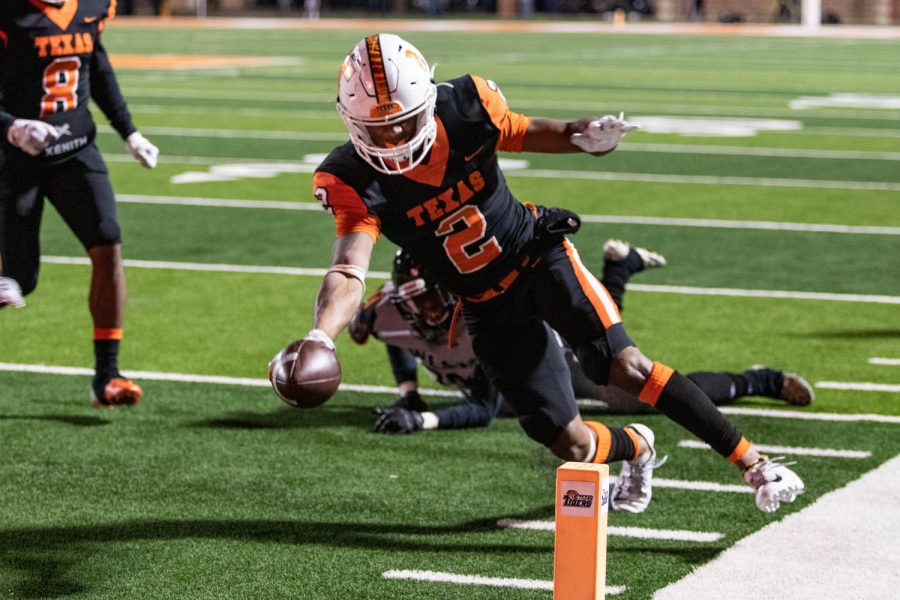 Senior runnig back Tracy Cooper reaches for the goal line to score a touchdown for Texas High in the third quarter against West Mesquite. The Tigers secured a play off birth with a 41-14 win.