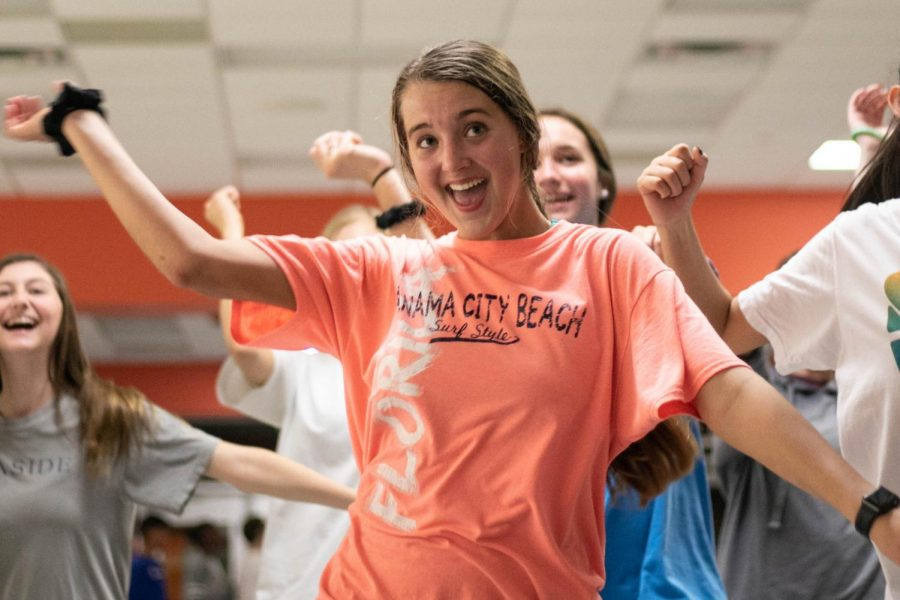 Sophomore Carrigan Brush dances to a Just Dance video during the Sock Hop. The event was held to raise funds to build a well in Uganda.