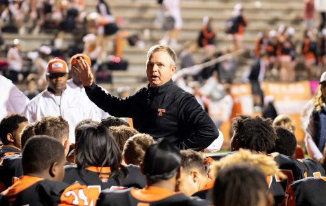 Texas High athletic director and head football coach Gerry Stanford speaks to players after a game. The Texas High Tigers advanced to playoffs after a game against West Mesquite.